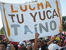 220px-Slogan-OC-Cuba